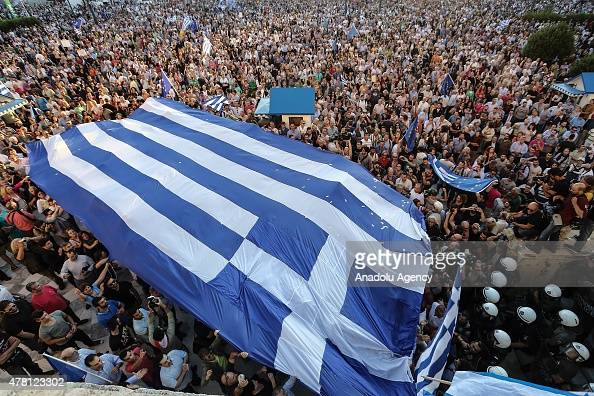Anti government demonstrators hold flags and shout slogans during a rally demanding on Greece remain Euro zone at Sintagma Square on June 22 2015 in...
