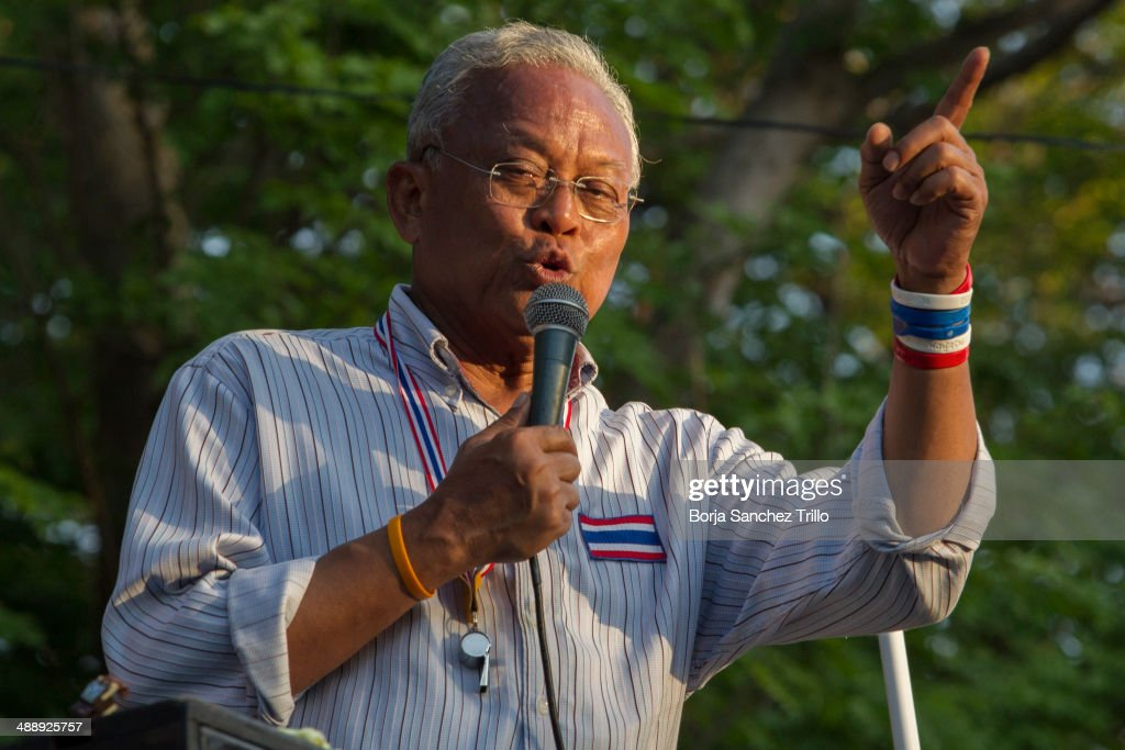 Anti government leader, <a gi-track='captionPersonalityLinkClicked' href=/galleries/search?phrase=Suthep+Thaugsuban&family=editorial&specificpeople=5734971 ng-click='$event.stopPropagation()'>Suthep Thaugsuban</a>, talks to his supporters in front of the Parliament House on May 9, 2014 in Bangkok, Thailand. Anti government protestors, known as yellow shirts, take to the streets of Thailand to show their support for opposition leader <a gi-track='captionPersonalityLinkClicked' href=/galleries/search?phrase=Suthep+Thaugsuban&family=editorial&specificpeople=5734971 ng-click='$event.stopPropagation()'>Suthep Thaugsuban</a>. Earlier this week Thai Prime Minister Yingluck Shinawatra was thrown out of government by the Constitutional Court for abuse of power.
