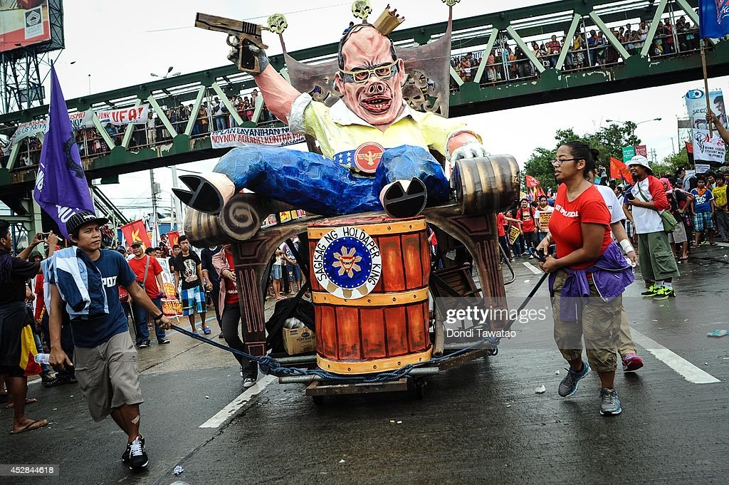 Anti government protestors march with an effigy of President Benigno Aquino on July 28, 2014 in Manila, Philippines. Thousands of government protestors staged a rally to protest the alleged corruption of Aquino involving the Disbursement Allocation Programme, a 145-billion-peso ($3.34-billion) fund to boost public spending but some of the funds went to favored allies in the Lower House of Representatives.