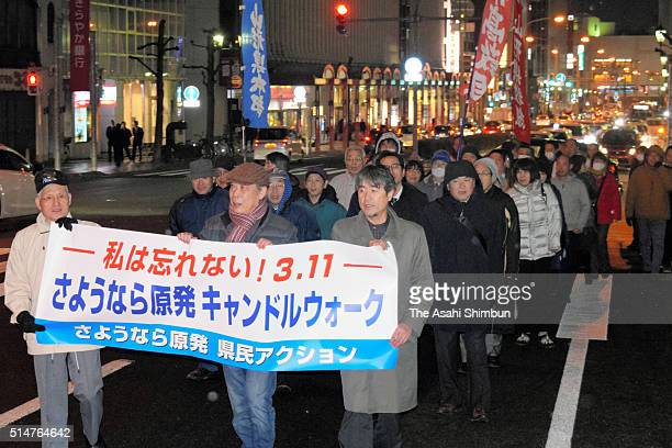 Anti nuclear protesters march on during a rally on the fifth anniversary of the Great East Japan Earthquake on March 11 2016 in Yamagata Japan Japan...