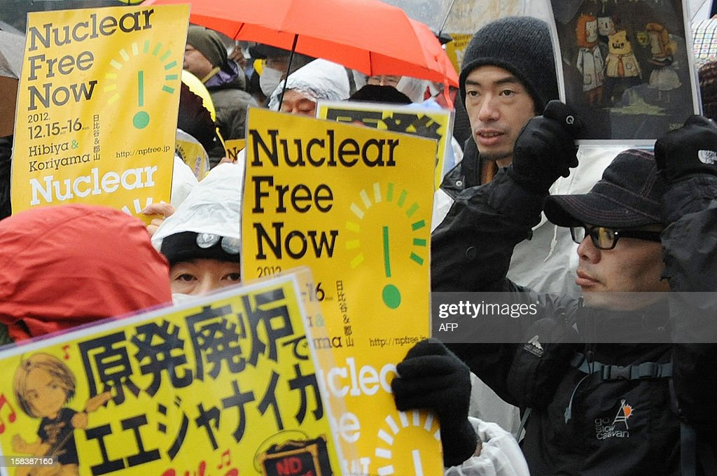 Anti nuclear protestors hold placards as they march in Tokyo on December 15, 2012 as some 3000 people held a rally. High-level officials, including government ministers, from more than 50 countries and organisations gathered at Fukushima to hold a three-day international conference on nuclear safety. AFP PHOTO / Rie ISHII