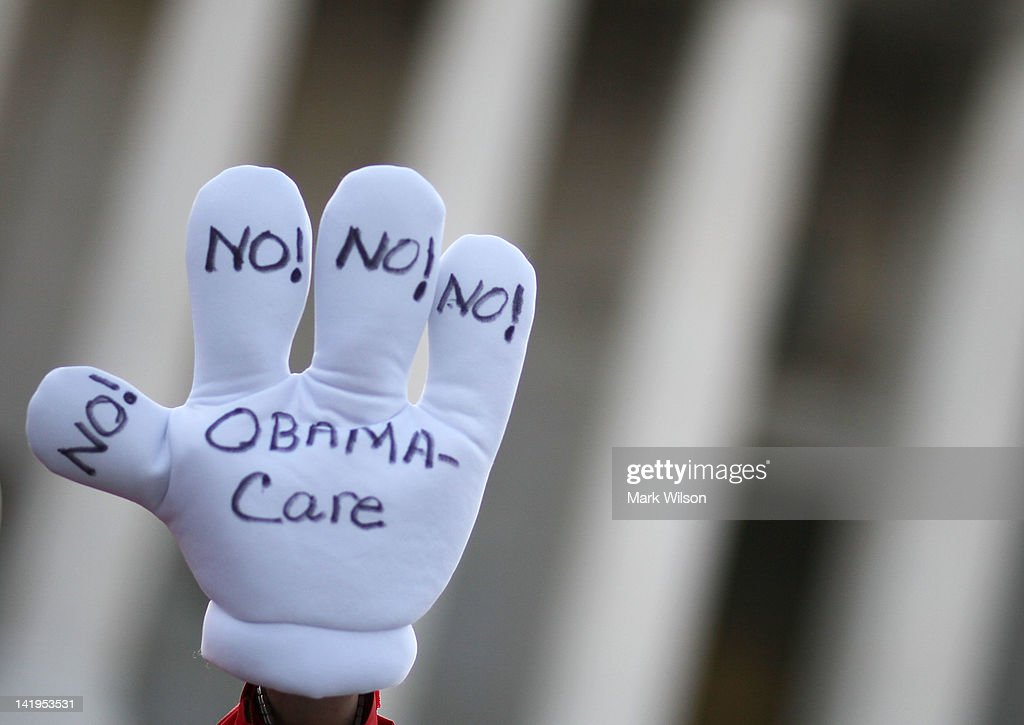 A anti Obama health care glove is worn in front of the U.S. Supreme Court building, on March 27, 2012 in Washington, DC. Today is the second of three days the high court has set aside to hear six hours of arguments over the constitutionality of President Barack Obama's Patient Protection and Affordable Care Act.