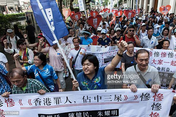 Anti Occupy 'Blue Ribbon' group members shout slogans as they take part in a protest march towards an area near the Occupy camp in the Mong Kok...