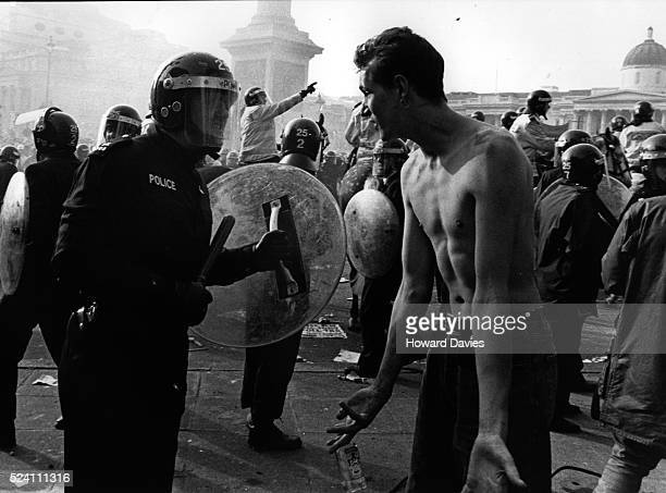 Anti poll tax demonstrators confront the police in Trafalgar square during the anti poll tax riots of April 1990 UK