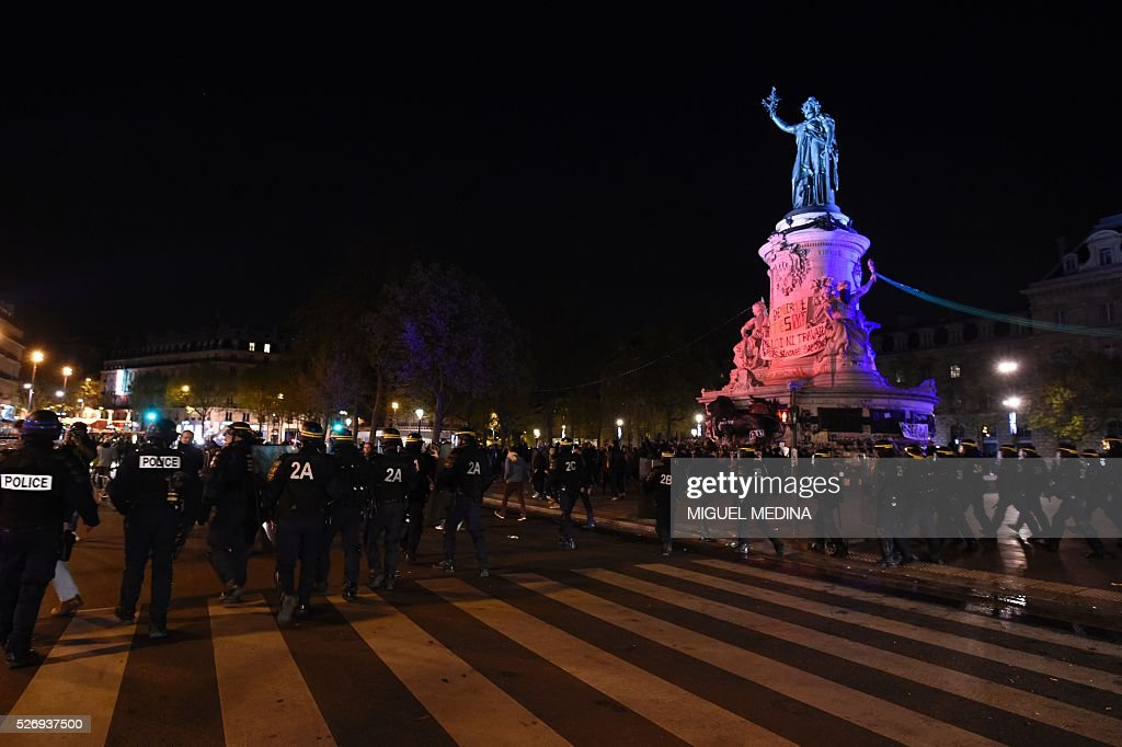 Anti riot French policemen face protesters at the Place de la Republique during a protest by the Nuit Debout (Up All Night) movement against the French government's proposed labour reform, on May 1, 2016 in Paris.