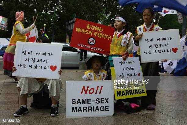 Anti samesex marriage activists attend the rally next to the Korea Queer Culture Festival 2017 in front of City hall on July 15 2017 in Seoul South...