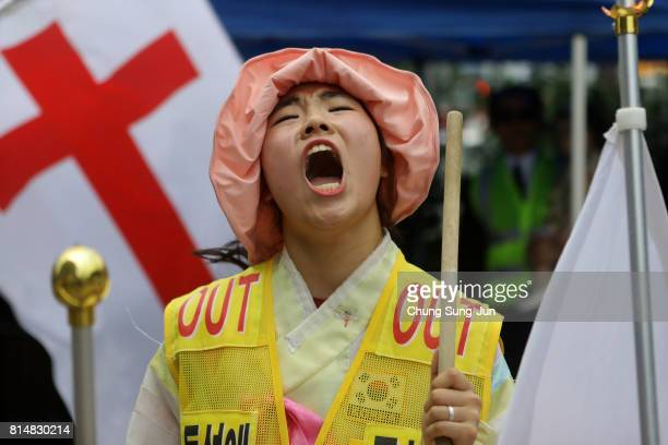 Anti samesex marriage activists play drums and shout slogans near to the Korea Queer Festival 2017 in front of City hall on July 15 2017 in Seoul...