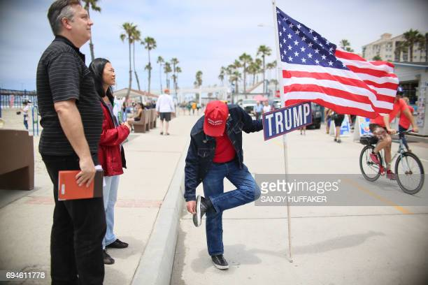 Anti Sharia Law and Trump supporter Sean Colgan puts his cigarette out on his shoe while participating in the March For Human rights and Against...