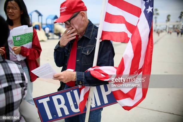 Anti Sharia Law and Trump supporter Sean Colgan smokes a cigarette while participating in the March For Human rights and Against Sharia law...