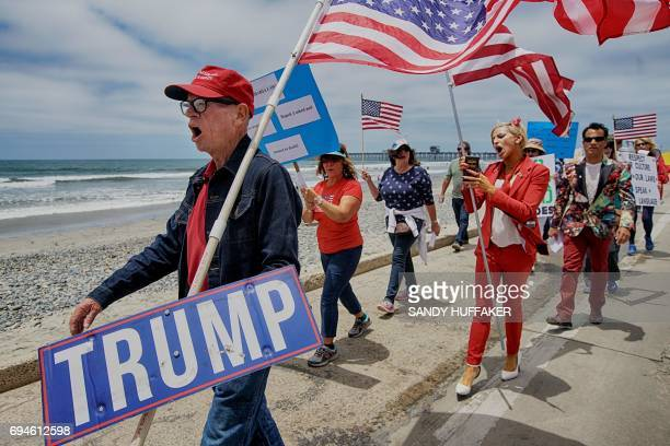 Anti Shariah Law and Trump supporters march along the beach during the March For Human rights and Against Sharia law demonstration in Oceanside...