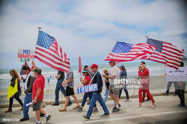Anti Shariah Law demonstrators march along the beach during the March For Human rights and Against Sharia law demonstration in Oceanside California...