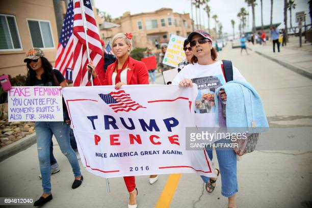 Anti Shariah Law supporters march along the Strand during the March For Human rights and Against Sharia law demonstration in Oceanside California on...