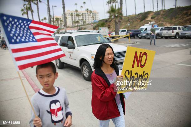 Anti Shariah Law supporters march during the March For Human rights and Against Sharia law demonstration in Oceanside California on Saturday June 10...