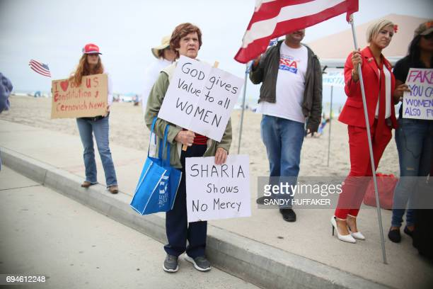 Anti Shariah Law supporters rally during the March For Human rights and Against Sharia law demonstration in Oceanside California on Saturday June 10...