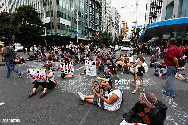 Anti TPP protests block intersections on Queen Street during the signing of the document on February 4 2016 in Auckland New Zealand The signing...