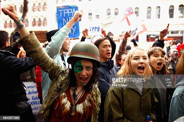 Anti TPPA protestors gather around the US Embassy following a protest march down Queen Street on August 15 2015 in Auckland New Zealand The...
