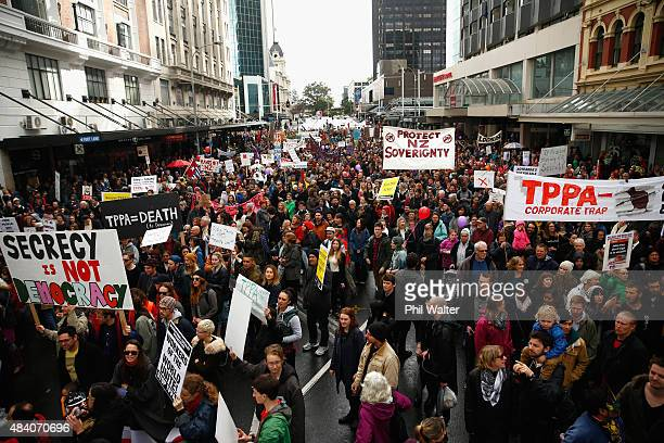 Anti TPPA protestors march down Queen Street on August 15 2015 in Auckland New Zealand The TransPacific Partnership Agreement is a proposed regional...