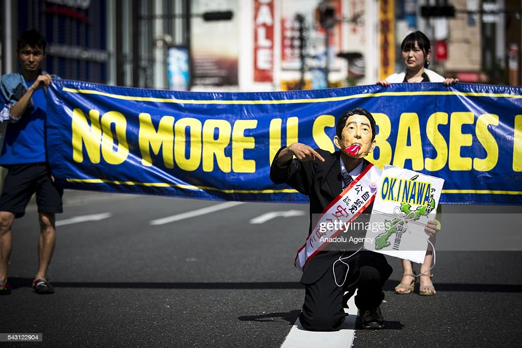 Anti U.S Airbase protesters gather during the demonstration to oppose the relocation of a U.S. Airbase in Okinawa in Shinjuku, Tokyo, Japan on June 26, 2016.