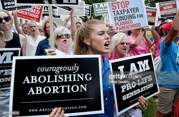 Antiabortion activists hold a rally opposing federal funding for Planned Parenthood in front of the US Capitol July 28 2015 in Washington DC