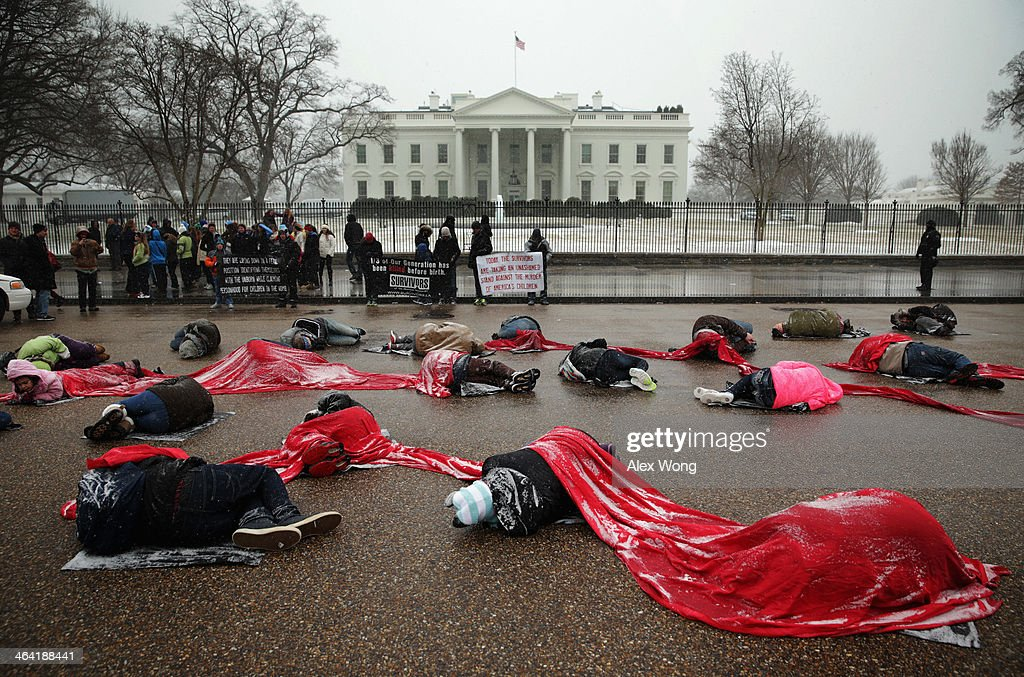 ro-Life Activists participate in a 'Memorial Die-in' outside the White House, photo by Alex Wong of Getty Images