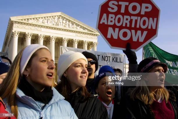 Antiabortion activists shout slogans as they protest outside the US Supreme Court January 22 2001 after a march in Washington The march was held to...