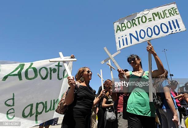Antiabortion activists show banners and crosses as the Uruguayan Senate votes a bill decriminalizing abortion punishable by imprisonment since 1938...