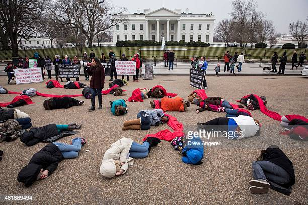 Antiabortion advocates stage a 'diein' protest at Lafayette Square near the White House January 21 2015 in Washington DC In a written statement on...
