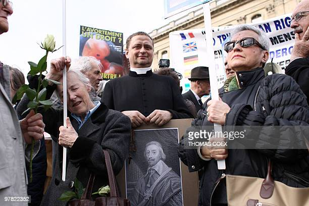 Antiabortion demonstrators protest on March 18 2010 in front of the Institute of France in Paris during the welcoming reception of French former...