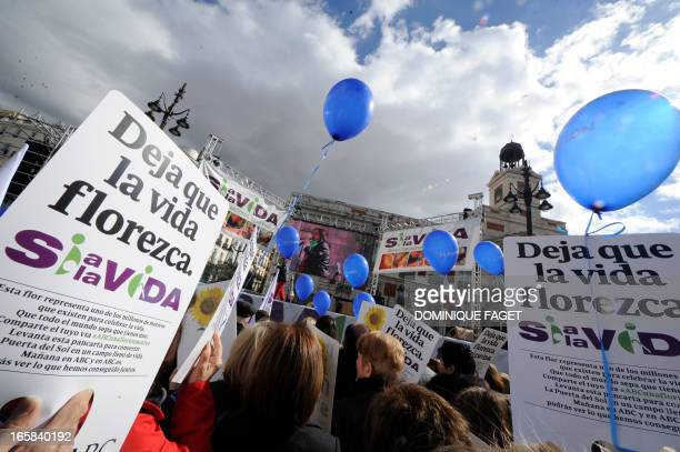 Antiabortion demonstrators take part in a gathering 'Si a la vida' at the Puerta del Sol in the centre of Madrid on April 6 2013 AFP PHOTO/ DOMINIQUE...