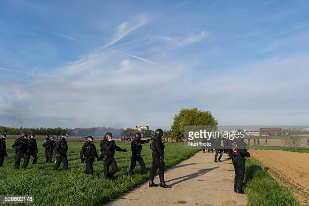 AntiAFD demonstrators and police forces face near the AfD party's federal congress at the Stuttgart Congress Centre ICS on April 30 2016 in Stuttgart...