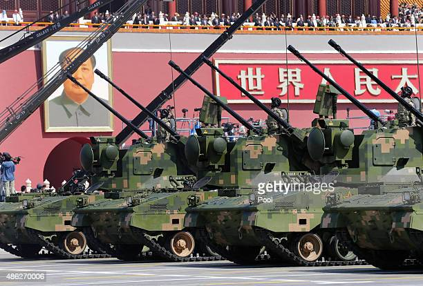 Antiaircraft artilleries drive past the Tiananmen Gate during a military parade to mark the 70th anniversary of the end of World War Two on September...