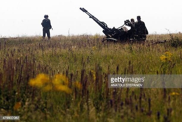Antiaircraft gunners of Ukrainian forces take part in exercises not far from southeastern city of Mariupol Donetsk region on July 7 2015 Kiev said on...