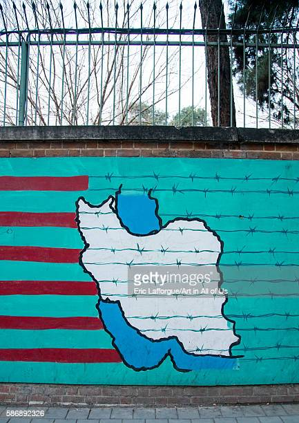 Antiamerican mural propoganda on the wall of the former united states embassy central district tehran Iran on December 20 2015 in Tehran Iran