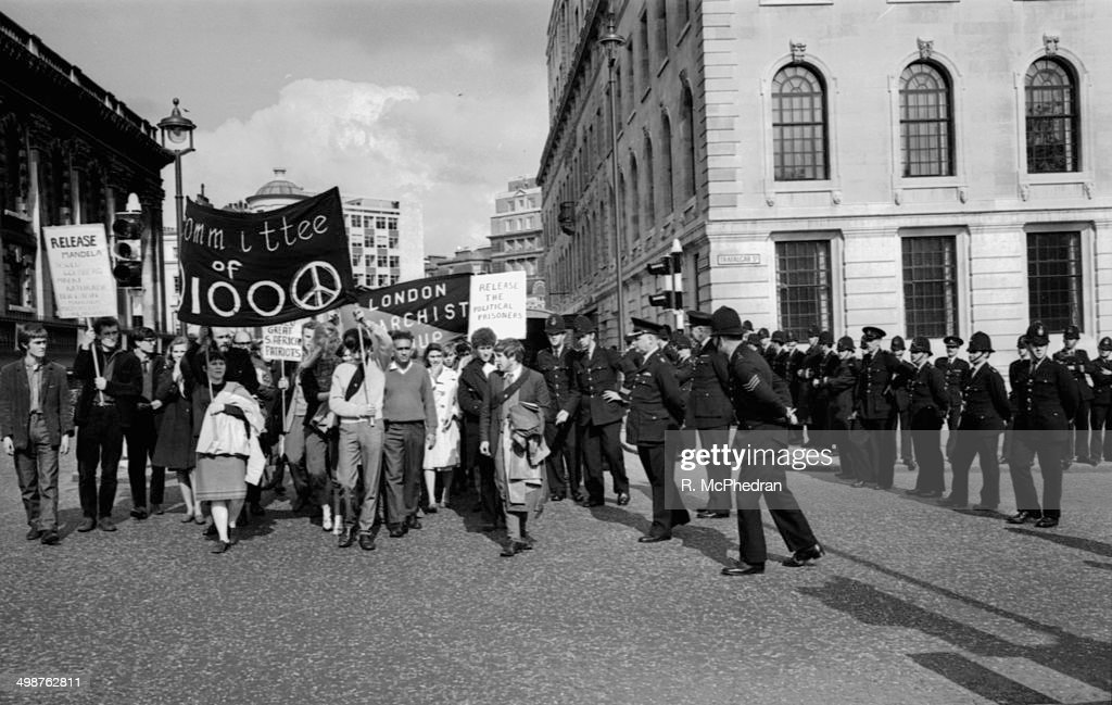 Antiapartheid demonstrators and police outside South Africa House London June 14th 1964