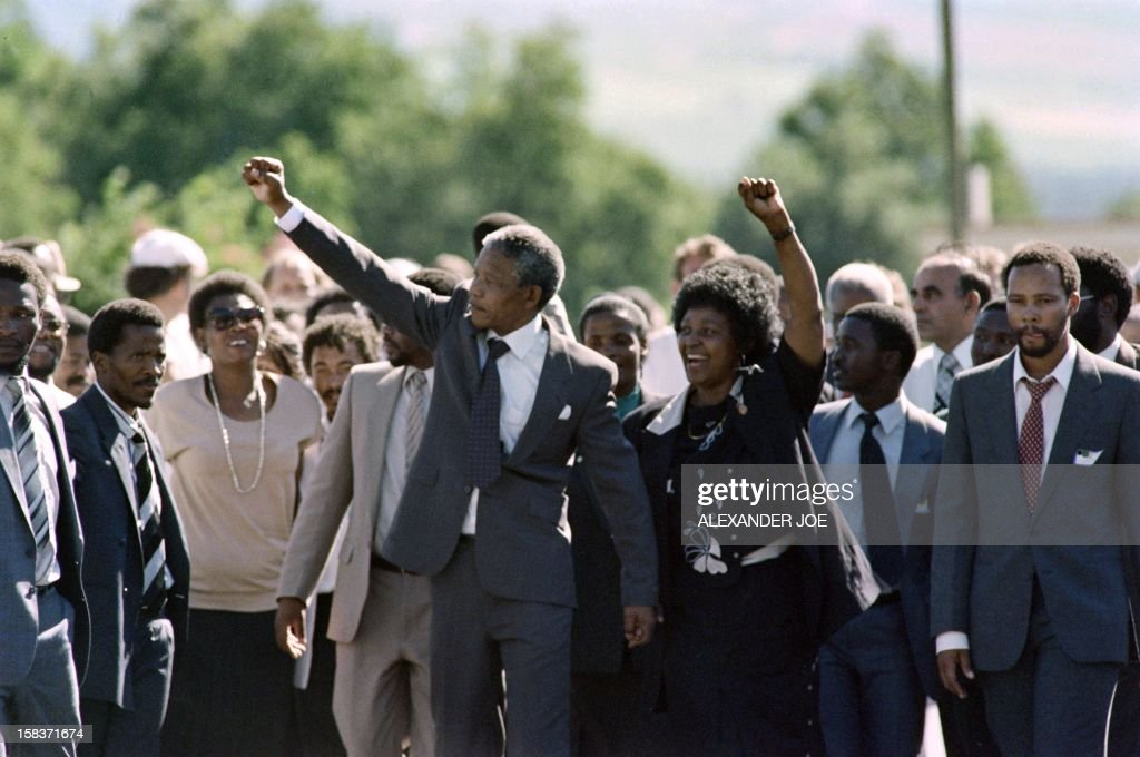 Anti-apartheid leader and African National Congress (ANC) member <a gi-track='captionPersonalityLinkClicked' href=/galleries/search?phrase=Nelson+Mandela&family=editorial&specificpeople=118613 ng-click='$event.stopPropagation()'>Nelson Mandela</a> (C, L) and his wife Winnie raise fists upon Mandela's release from Victor Verster prison on February 11, 1990 in Paarl.