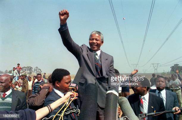 Antiapartheid leader and African National Congress member Nelson Mandela raises fist while addressing on September 05 1990 in Tokoza a crowd of...