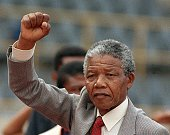 Antiapartheid leader and African National Congress member Nelson Mandela raises clenched fist arriving to address mass rally a few days after his...