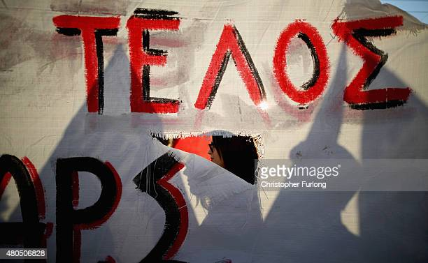 Antiausterity demonstrators gather in front of the Greek parliament as Eurozone leaders in Brussels continue their discussions on July 12 2015 in...