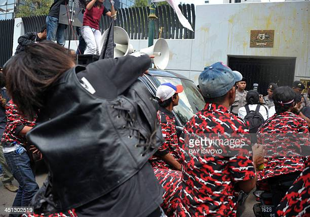 AntiAustralia protesters throw bottles of urine eggs and tomatoes during a rally in front of the Australian embassy in Jakarta on November 22 2013...