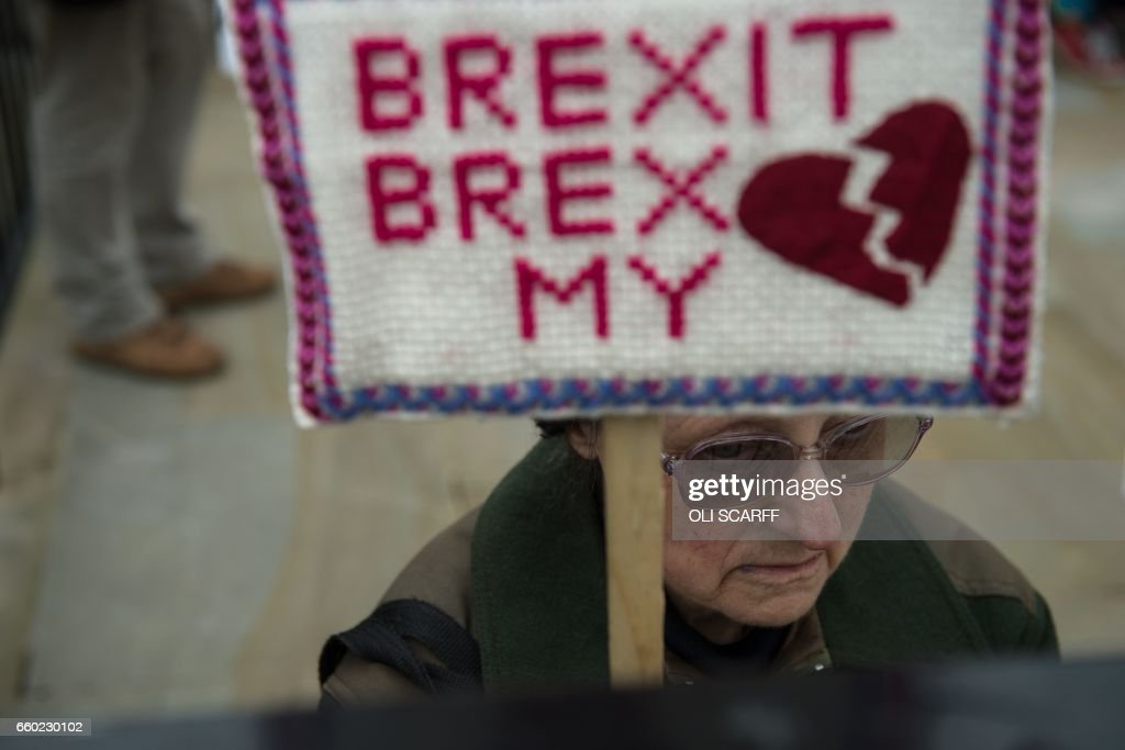 TOPSHOT - Anti-Brexit protesters demonstrate on Whitehall opposite Downing Street in London, on March 29, 2017 after Britain formally invoked Article 50 to start the process of withdrawl from the EU. Britain formally launched the process for leaving the European Union on March 29, a historic move that has split the country and thrown into question the future of the European project. /