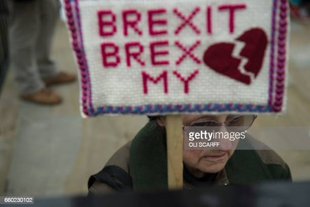 TOPSHOT AntiBrexit protesters demonstrate on Whitehall opposite Downing Street in London on March 29 2017 after Britain formally invoked Article 50...