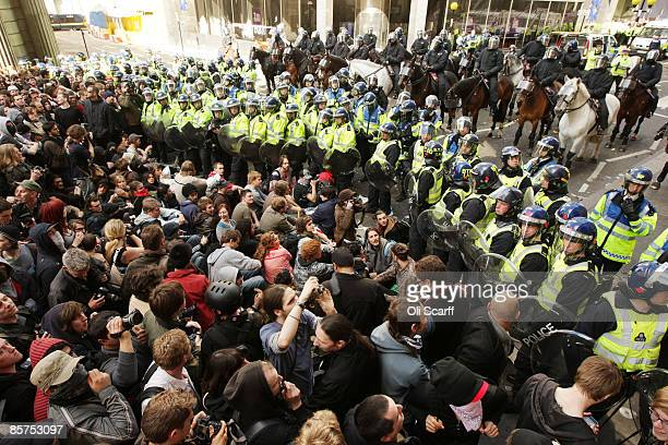Anticapitalist and climate change activists demonstrate in the City of London on April 1 2009 in London England Protesters marched through London...