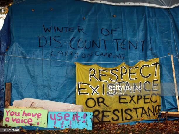 Anticapitalist protest signs are seen at the Occupy Bristol protest camp on November 3 2011 in Bristol England The demonstrators inspired by the...