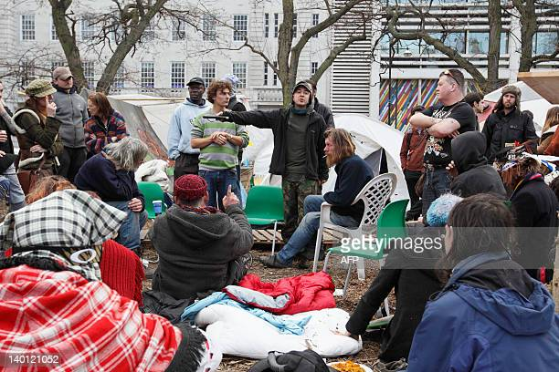 Anticapitalist protesters hold a general meeting in the afternoon at the Finsbury Square 'Occupy' site in London on February 28 2012 Police tore down...