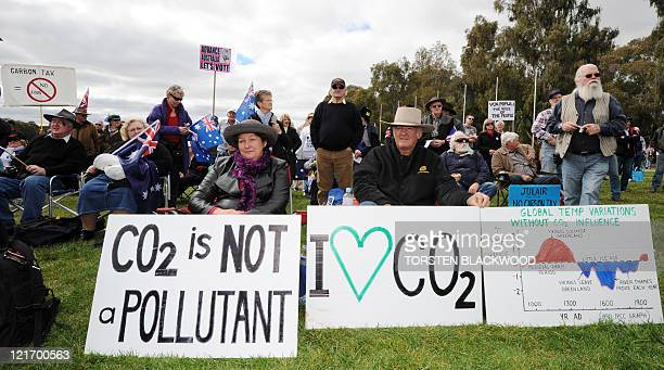Anticarbon tax protesters known as The Convoy of No Confidence listen to speeches in front of Parliament House in Canberra on August 22 2011 The...