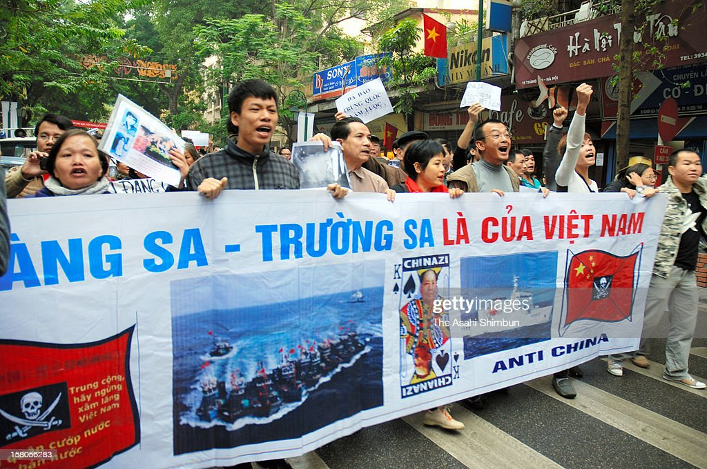 Anti-China protesters march on toward Chinese Embassy on December 9, 2012 in Hanoi, Vietnam. Territorial tension heightens over the South China Sea as a Chinese vessel cut the cable of survey ship of the Vietnam's state-owned oil company at the end of November.