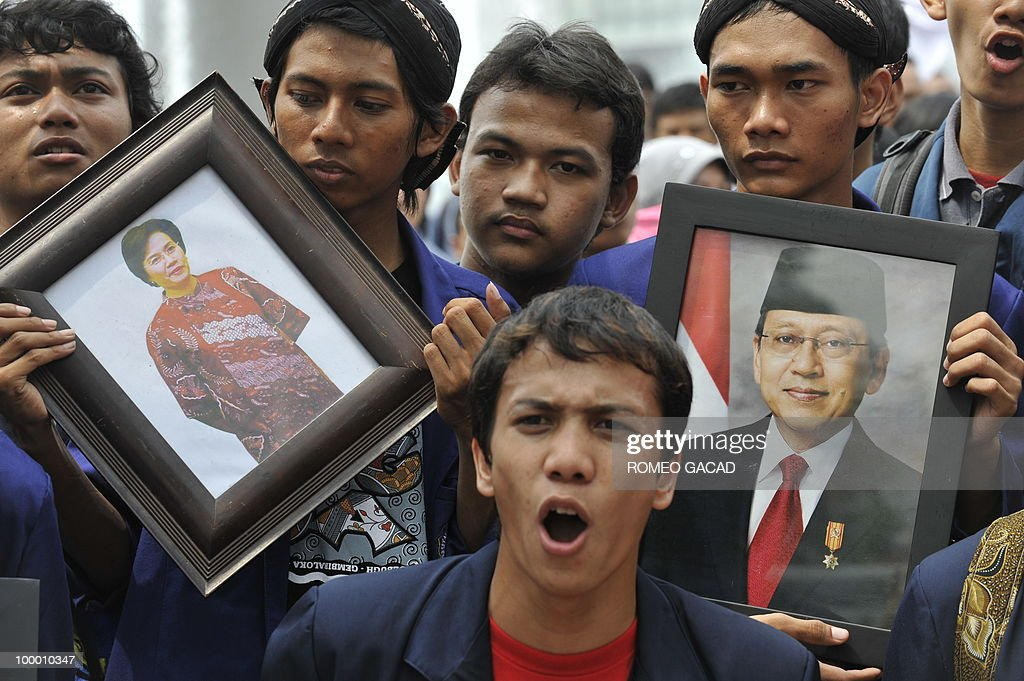 Anti-corruption demonstrators display portraits of resigned finance minister Sri Mulyani Indrawati (L) and Vice President Boediono (R) during a rally in Jakarta on May 20, 2010. Yudhoyono appointed PT Bank Mandiri chief Agus Martowardojo as the new finance minister after the shock resignation of independent economist Sri Mulyani Indrawati. Protestors denounce Indrawati and Vice President Boediono for their alleged role in a controversial bank bailout.