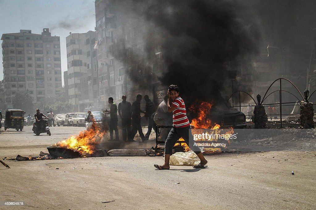 Anti-coup protestors clash with security forces during a demonstration on World Rabaa Day marking the 1st anniversary of the killing of hundreds of Morsi supporters by security forces in Cairo's Rabaa al-Adawiya Square and Giza's Al-Nahda square, on August 14, 2014 in Matariya northern district of Cairo, Egypt. Supporters of Mohamed Morsi staged demonstrations Thursday morning in parts of Egypt to commemorate one year since security forces violently cleared two major pro-Morsi protest encampments in Cairo's Rabaa al-Adawiya and Nahda Square.