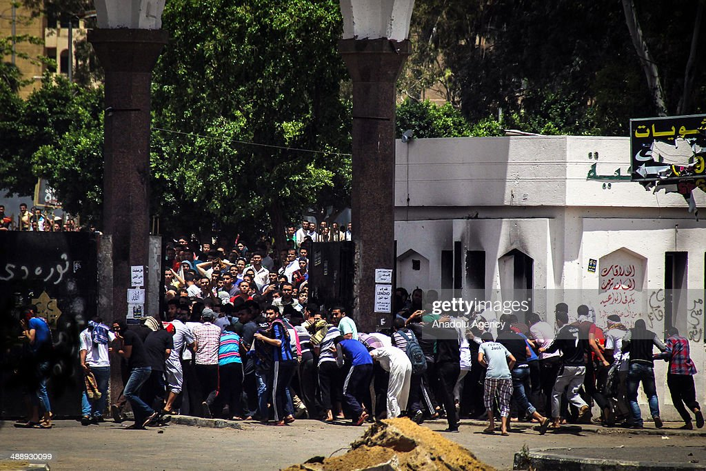 Anti-coup students gather to protest in Al-Azhar University in Cairo, Egypt on 9 May, 2014. Security forces intervene to protestors.