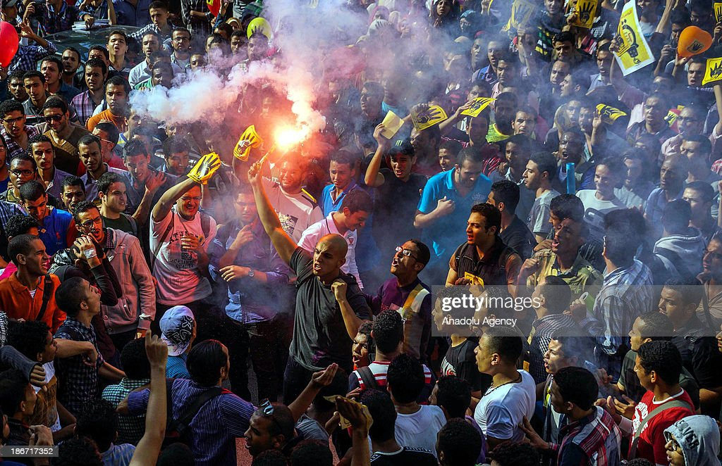 Anti-coup students of Alexandria University shout slogans during a demonstration on November 3, 2013 in Alexandria, Egypt to call for the release of the student being detained while protesting against military coup.